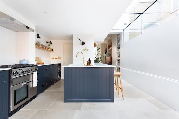 blue-kitchen-furniture-in-white-painted-kitchen-with-cream-tiles-in-house-located-on-Green-Lanes