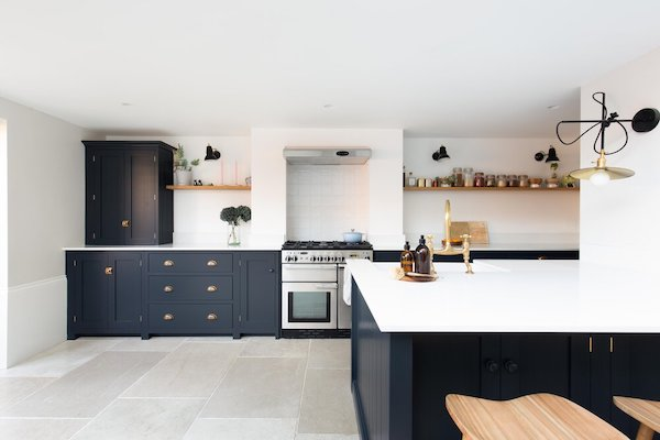 blue-kitchen-furniture-with-white-marble-tops-in-kitchen-tiled-with-ceramic-tiles