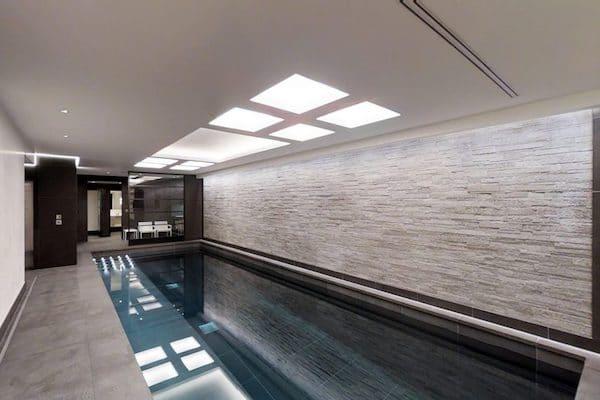 dark-grey-ceramic-tiles-laid-in-private-swimming-pool-inside-mansion