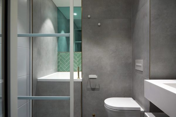 white-sanitary-ware-in-bathroom-tiled-with-grey-tiles-in-house